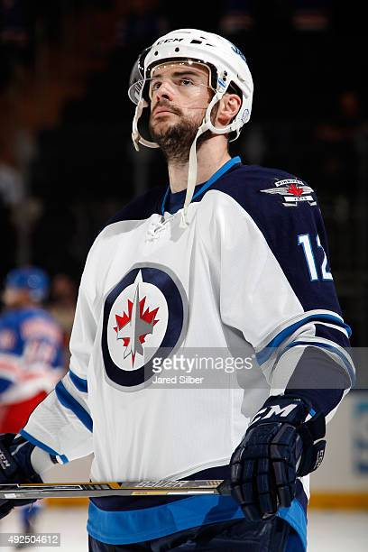 Drew Stafford of the Winnipeg Jets looks on during pregame warm ups before the game against the New York Rangers at Madison Square Garden on October...