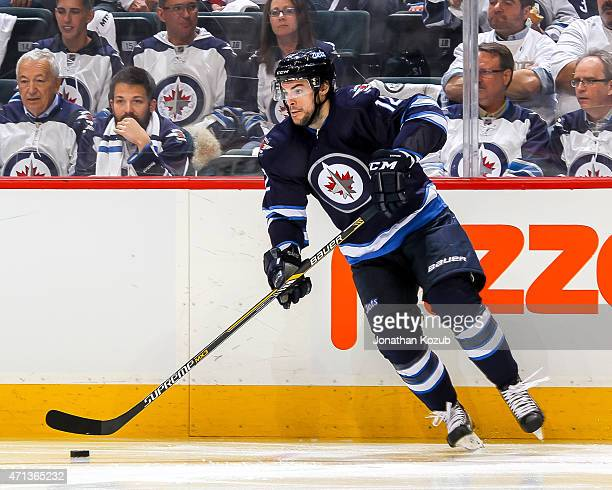Drew Stafford of the Winnipeg Jets plays the puck along the boards during second period action against the Anaheim Ducks in Game Four of the Western...