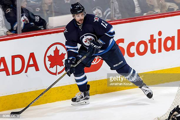 Drew Stafford of the Winnipeg Jets plays the puck behind the net during third period action against the Dallas Stars at the MTS Centre on February 2...
