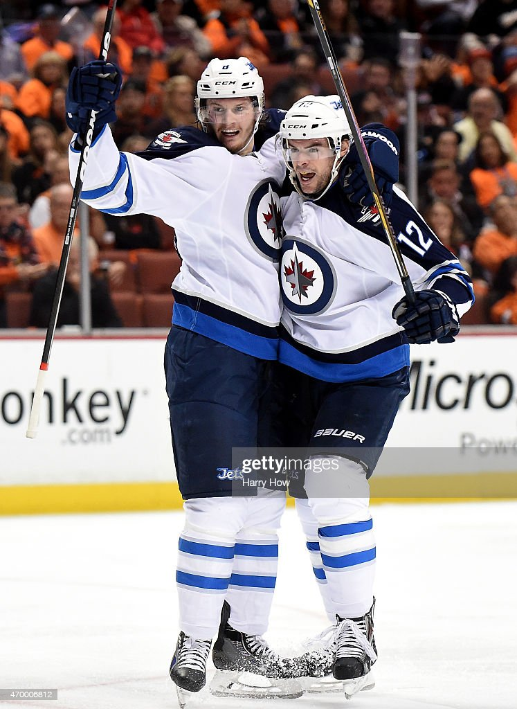 <a gi-track='captionPersonalityLinkClicked' href=/galleries/search?phrase=Drew+Stafford&family=editorial&specificpeople=220617 ng-click='$event.stopPropagation()'>Drew Stafford</a> #12 of the Winnipeg Jets reacts to his goal with <a gi-track='captionPersonalityLinkClicked' href=/galleries/search?phrase=Jacob+Trouba&family=editorial&specificpeople=8050718 ng-click='$event.stopPropagation()'>Jacob Trouba</a> #8 to take a 2-1 lead over the Anaheim Ducks during the second period in Game One of the Western Conference Quarterfinals during the 2015 NHL Stanley Cup Playoffs at Honda Center on April 16, 2015 in Anaheim, California.