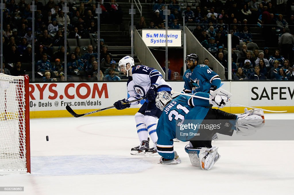 <a gi-track='captionPersonalityLinkClicked' href=/galleries/search?phrase=Drew+Stafford&family=editorial&specificpeople=220617 ng-click='$event.stopPropagation()'>Drew Stafford</a> #12 of the Winnipeg Jets scores a shorthanded goal on <a gi-track='captionPersonalityLinkClicked' href=/galleries/search?phrase=Martin+Jones+-+Ice+Hockey+Player&family=editorial&specificpeople=12318960 ng-click='$event.stopPropagation()'>Martin Jones</a> #31 of the San Jose Sharks at SAP Center on January 2, 2016 in San Jose, California.