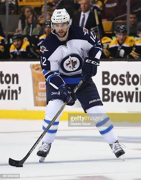Drew Stafford of the Winnipeg Jets skates against the Boston Bruins during the third period at TD Garden on October 8 2015 in Boston Massachusetts...
