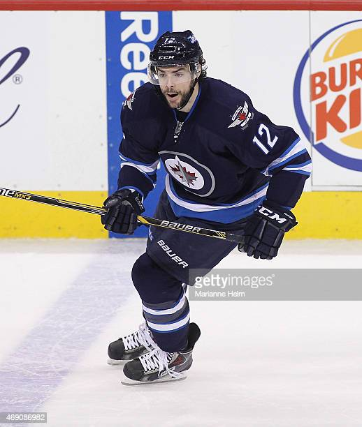 Drew Stafford of the Winnipeg Jets skates down the ice during thirdperiod action in an NHL game against the Vancouver Canucks at the MTS Centre on...