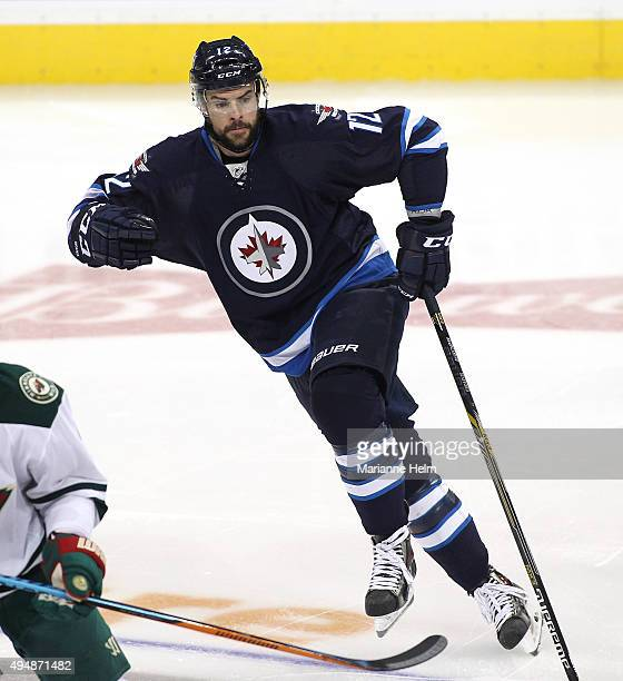 Drew Stafford of the Winnipeg Jets skates down the ice during first period action in an NHL game against the Minnesota Wild at the MTS Centre on...