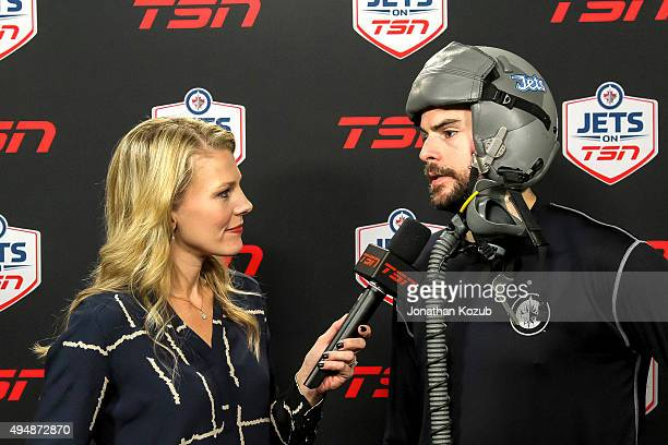 Drew Stafford of the Winnipeg Jets sports a fighter pilot helmet awarded to the team's player of the game as chosen by his teammates during an...