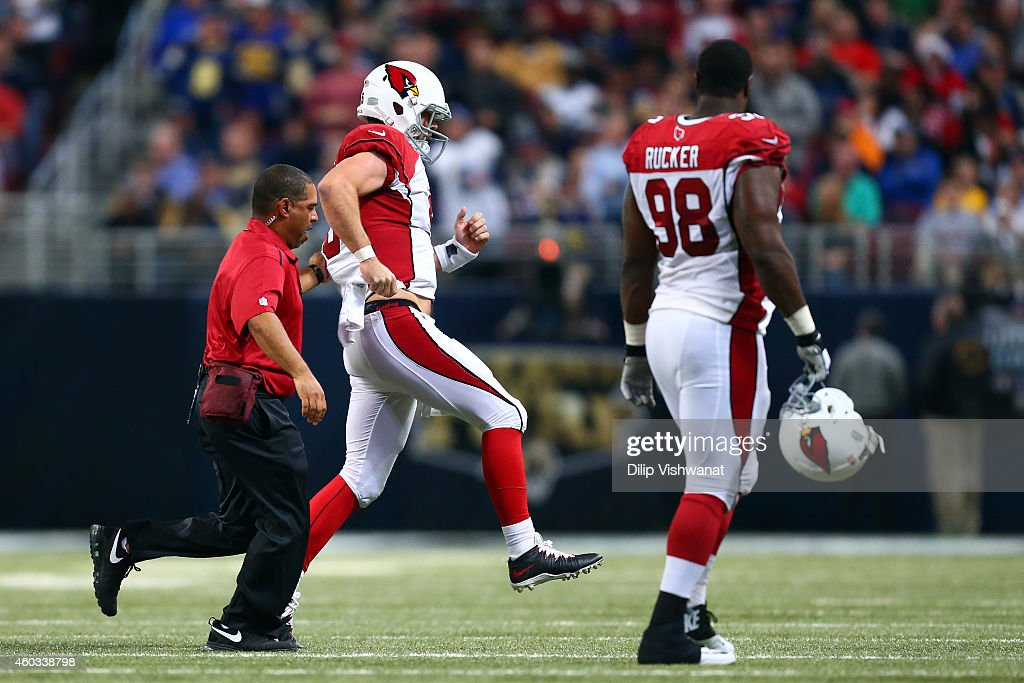 Drew Stanton #5 of the Arizona Cardinals hobbles off the field after being sacked by Aaron Donald #99 of the St. Louis Rams in the third quarter during their game at Edward Jones Dome on December 11, 2014 in St Louis, Missouri.