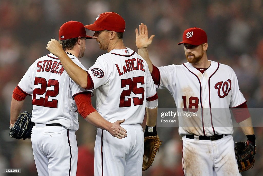 <a gi-track='captionPersonalityLinkClicked' href=/galleries/search?phrase=Drew+Storen&family=editorial&specificpeople=5926519 ng-click='$event.stopPropagation()'>Drew Storen</a> #22, <a gi-track='captionPersonalityLinkClicked' href=/galleries/search?phrase=Adam+LaRoche&family=editorial&specificpeople=216533 ng-click='$event.stopPropagation()'>Adam LaRoche</a> #25, and <a gi-track='captionPersonalityLinkClicked' href=/galleries/search?phrase=Chad+Tracy&family=editorial&specificpeople=213807 ng-click='$event.stopPropagation()'>Chad Tracy</a> #18 of the Washington Nationals celebrate after the Nationals defeated the Philadelphia Phillies 4-2 at Nationals Park on October 2, 2012 in Washington, DC.