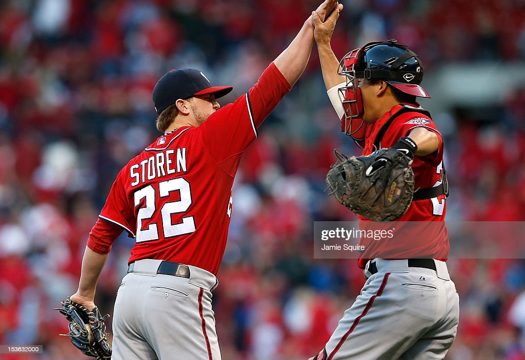 <a gi-track='captionPersonalityLinkClicked' href=/galleries/search?phrase=Drew+Storen&family=editorial&specificpeople=5926519 ng-click='$event.stopPropagation()'>Drew Storen</a> #22 and <a gi-track='captionPersonalityLinkClicked' href=/galleries/search?phrase=Kurt+Suzuki&family=editorial&specificpeople=682702 ng-click='$event.stopPropagation()'>Kurt Suzuki</a> #24 of the Washington Nationals celebrate after the final pitch to defeat the St Louis Cardinals during Game One of the National League Division Series at Busch Stadium on October 7, 2012 in St Louis, Missouri.