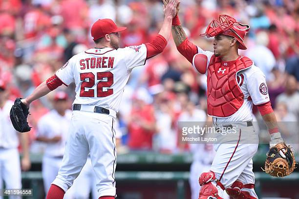 Drew Storen and Wilson Ramos of the Washington Nationals celebrate a win after a baseball game against the New York Mets at Nationals Park on July 22...