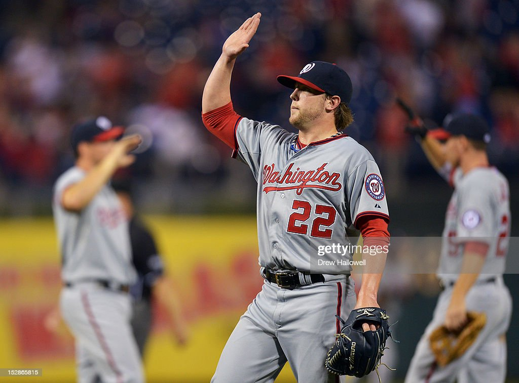 Drew Storen #22, Danny Espinosa #8 and Adam LaRoche #25 of the Washington Nationals raise their hands for high fives after beating the Philadelphia Phillies 7-3 at Citizens Bank Park on September 27, 2012 in Philadelphia, Pennsylvania.