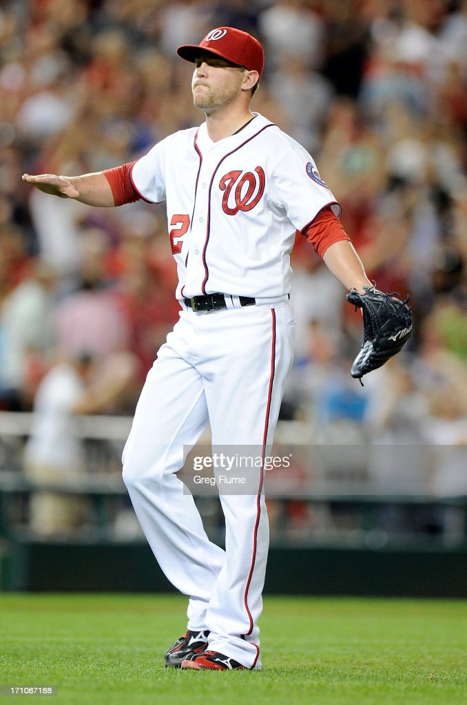 <a gi-track='captionPersonalityLinkClicked' href=/galleries/search?phrase=Drew+Storen&family=editorial&specificpeople=5926519 ng-click='$event.stopPropagation()'>Drew Storen</a> #22 of the Washington Nationals celebrates after the final out in the eighth inning against the Colorado Rockies at Nationals Park on June 21, 2013 in Washington, DC.