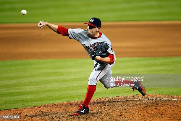 Drew Storen of the Washington Nationals delivers a pitch in the ninth inning against the Miami Marlins at Marlins Park on September 19 2014 in Miami...