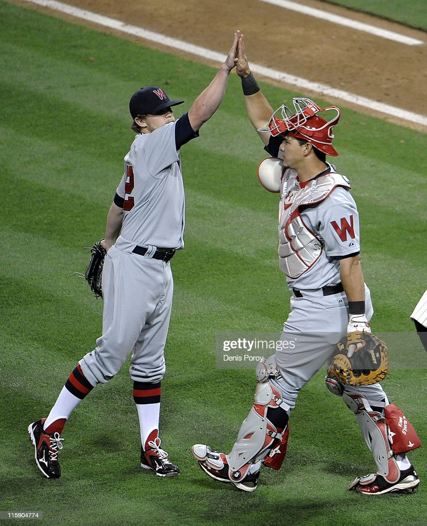 Drew Storen #22 of the Washington Nationals is congratulated by Wilson Ramos #3 after the Nationals beat the San Diego Padres 2-1 at Petco Park on June 11, 2011 in San Diego, California.