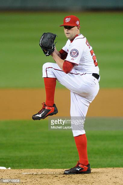 Drew Storen of the Washington Nationals pitches during a baseball game against the New York Mets at Nationals Park on April 8 2015 in Washington DC...