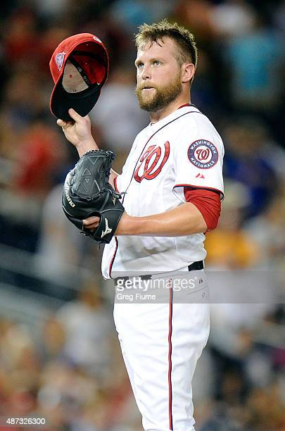 Drew Storen of the Washington Nationals reacts after walking in a run in the seventh inning against the New York Mets at Nationals Park on September...