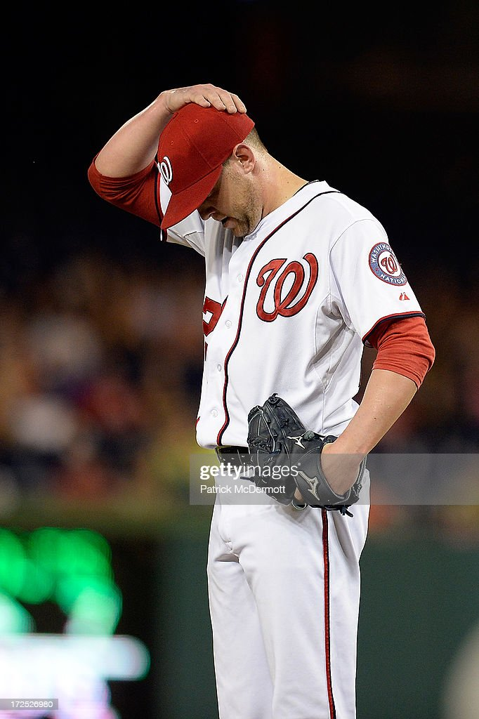 <a gi-track='captionPersonalityLinkClicked' href=/galleries/search?phrase=Drew+Storen&family=editorial&specificpeople=5926519 ng-click='$event.stopPropagation()'>Drew Storen</a> #22 of the Washington Nationals reacts in the eighth inning during a game against the Milwaukee Brewers at Nationals Park on July 2, 2013 in Washington, DC.