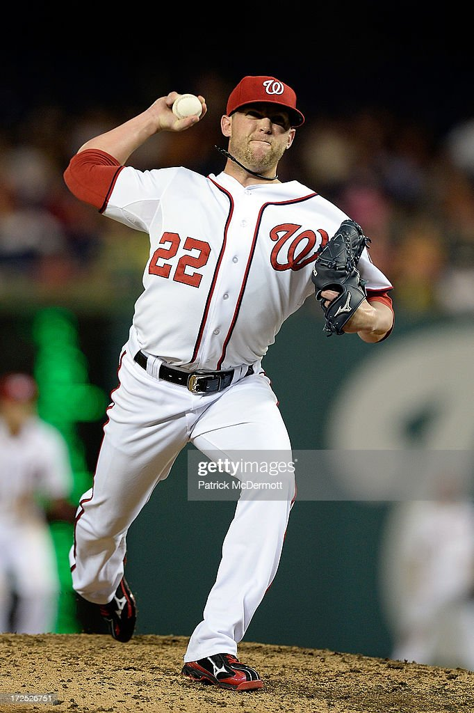 <a gi-track='captionPersonalityLinkClicked' href=/galleries/search?phrase=Drew+Storen&family=editorial&specificpeople=5926519 ng-click='$event.stopPropagation()'>Drew Storen</a> #22 of the Washington Nationals throws a pitch in the eighth inning during a game against the Milwaukee Brewers at Nationals Park on July 2, 2013 in Washington, DC.