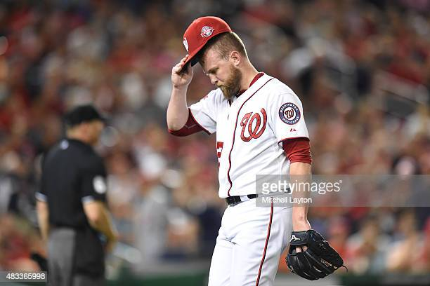 Drew Storen of the Washington Nationals walks back to the dug out after giving a grand slam to Carlos Gonzalez of the Colorado Rockies during a...