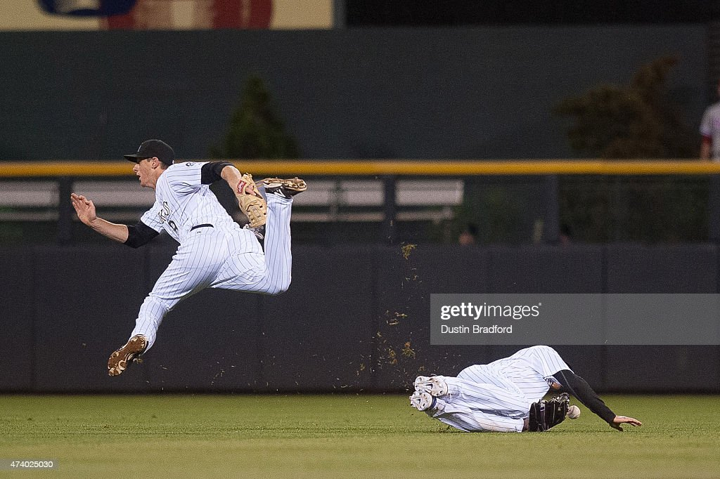 <a gi-track='captionPersonalityLinkClicked' href=/galleries/search?phrase=Drew+Stubbs+-+Baseball+Player&family=editorial&specificpeople=4498334 ng-click='$event.stopPropagation()'>Drew Stubbs</a> #13 and <a gi-track='captionPersonalityLinkClicked' href=/galleries/search?phrase=DJ+LeMahieu&family=editorial&specificpeople=5940806 ng-click='$event.stopPropagation()'>DJ LeMahieu</a> #9 of the Colorado Rockies collide as a fly ball falls into center field in the 8th inning of a game against the Philadelphia Phillies at Coors Field on May 19, 2015 in Denver, Colorado.