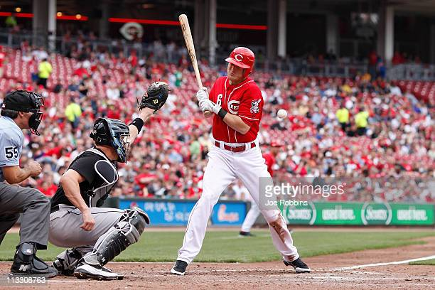 Drew Stubbs of the Cincinnati Reds gets hit by a pitch while batting against the Florida Marlins at Great American Ball Park on May 1 2011 in...