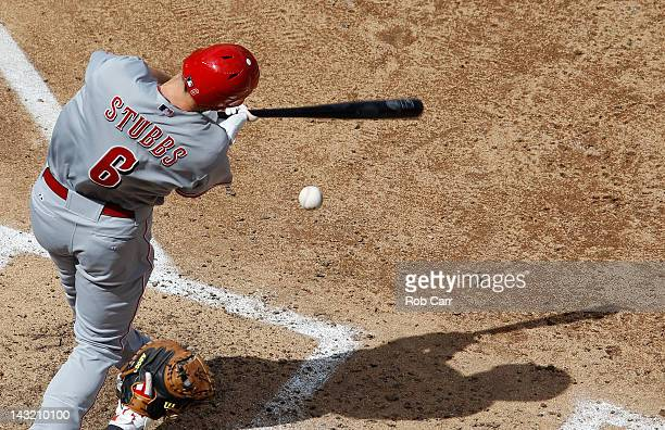 Drew Stubbs of the Cincinnati Reds misses a pitch against the Washington Nationals during opening day at Nationals Park on April 12 2012 in...