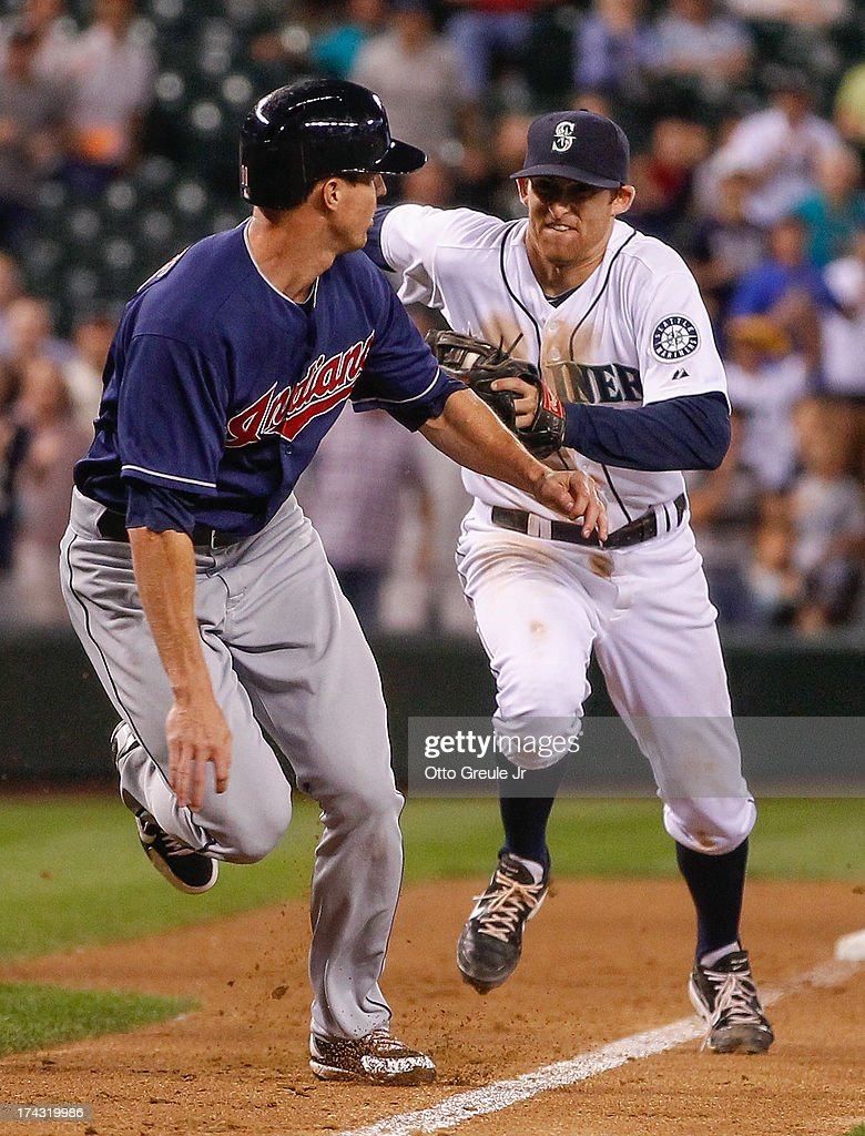 Drew Stubbs #11 of the Cleveland Indians is chased down by shortstop Brad Miller #5 of the Seattle Mariners on a double play in the ninth inning at Safeco Field on July 23, 2013 in Seattle, Washington.