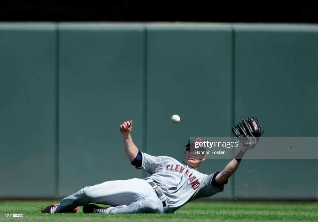 Drew Stubbs #11 of the Cleveland Indians misses a catch in center field of a ball hit by Brian Dozier #2 of the Minnesota Twins during the seventh inning of the game on July 21, 2013 at Target Field in Minneapolis, Minnesota. The Indians defeated the Twins 7-1.