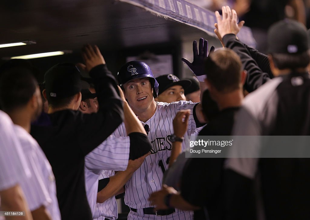 Drew Stubbs #13 of the Colorado Rockies celebrates his pinch hit solo home run off of Jason Motte #30 of the St. Louis Cardinals to give the Rockies a 9-5 lead in the eighth inning at Coors Field on June 24, 2014 in Denver, Colorado. The Rockies defeated the Cardinals 10-5.