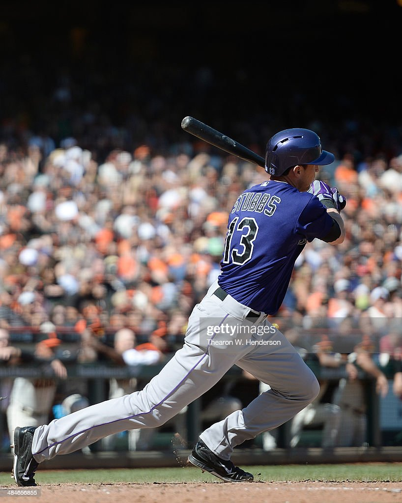 Drew Stubbs #13 of the Colorado Rockies gets a pinch-hit RBI single, scoring D.J. LeMahiew (not pictured) against the San Francisco Giants in the top of the eighth inning at AT&T Park on April 13, 2014 in San Francisco, California.