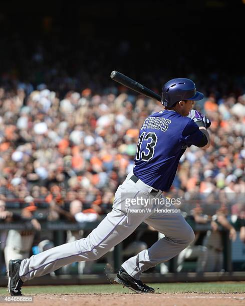 Drew Stubbs of the Colorado Rockies gets a pinchhit RBI single scoring DJ LeMahiew against the San Francisco Giants in the top of the eighth inning...