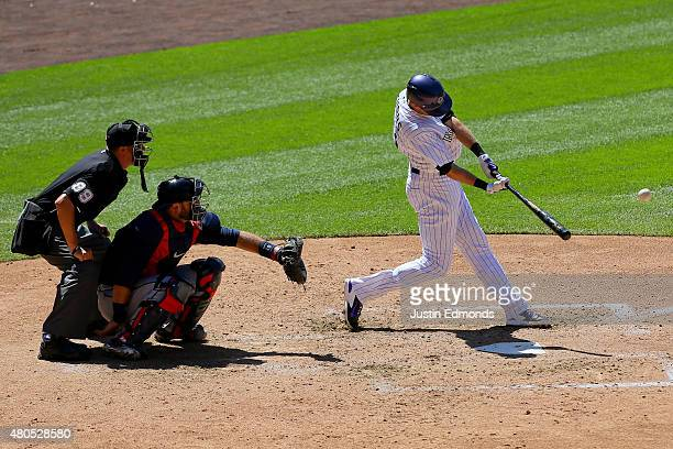 Drew Stubbs of the Colorado Rockies hits a triple during the fourth inning in front of catcher AJ Pierzynski of the Atlanta Braves and home plate...