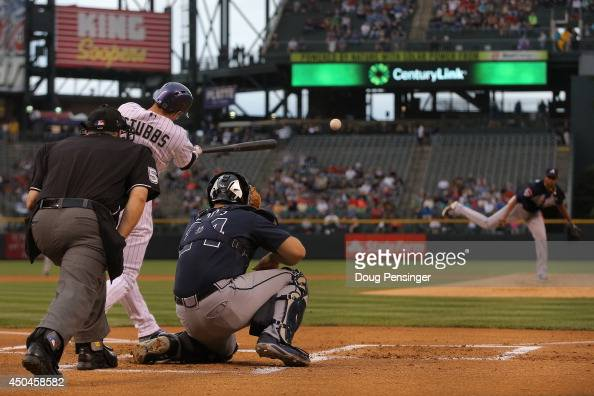 Drew Stubbs of the Colorado Rockies hits an RBI double off of starting pitcher Julio Teheran of the Atlanta Braves to score Josh Rutledge of the...