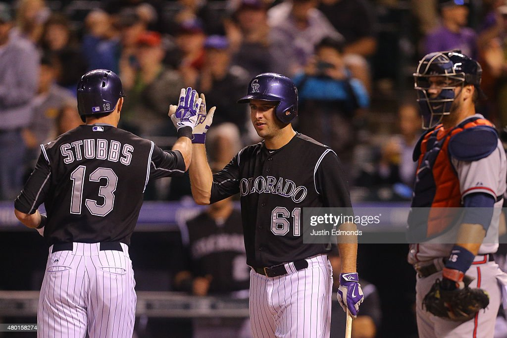 <a gi-track='captionPersonalityLinkClicked' href=/galleries/search?phrase=Drew+Stubbs+-+Baseball+Player&family=editorial&specificpeople=4498334 ng-click='$event.stopPropagation()'>Drew Stubbs</a> #13 of the Colorado Rockies is congratulated by <a gi-track='captionPersonalityLinkClicked' href=/galleries/search?phrase=David+Hale+-+Baseball+Player&family=editorial&specificpeople=15090027 ng-click='$event.stopPropagation()'>David Hale</a> #61 after his solo home run during the second inning as catcher <a gi-track='captionPersonalityLinkClicked' href=/galleries/search?phrase=A.J.+Pierzynski&family=editorial&specificpeople=204486 ng-click='$event.stopPropagation()'>A.J. Pierzynski</a> #15 of the Atlanta Braves looks on at Coors Field on July 9, 2015 in Denver, Colorado.