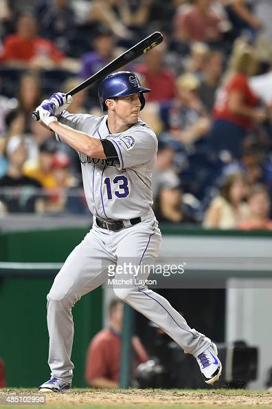 Drew Stubbs of the Colorado Rockies prepares for a pitch during a baseball game against the Washington Nationals at Nationals Park at on August 7...