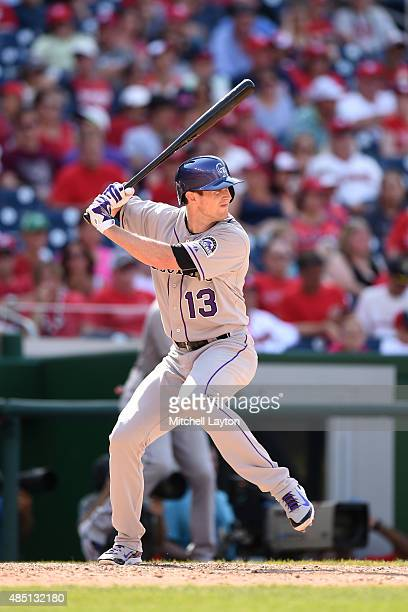 Drew Stubbs of the Colorado Rockies prepares for a pitch during a baseball game against the Washington Nationals at Nationals Park at on August 9...