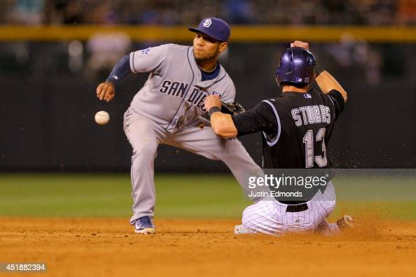 Drew Stubbs of the Colorado Rockies slides in safely to second base with a stolen base before shortstop Alexi Amarista of the San Diego Padres can...