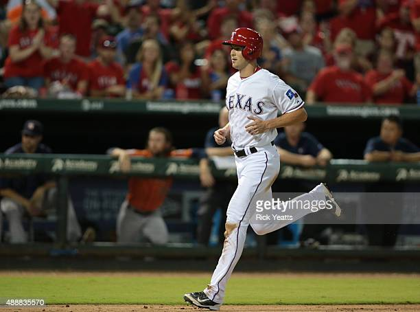 Drew Stubbs of the Texas Rangers steals home in the seventh inning on a wild pitch by Tony Sipp of the Houston Astros at Global Life Park in...