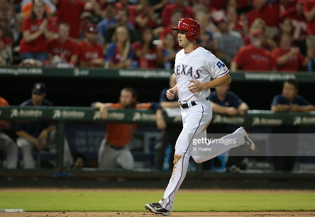<a gi-track='captionPersonalityLinkClicked' href=/galleries/search?phrase=Drew+Stubbs+-+Baseball+Player&family=editorial&specificpeople=4498334 ng-click='$event.stopPropagation()'>Drew Stubbs</a> #15 of the Texas Rangers steals home in the seventh inning on a wild pitch by Tony Sipp #29 of the Houston Astros at Global Life Park in Arlington on September 17, 2015 in Arlington, Texas.