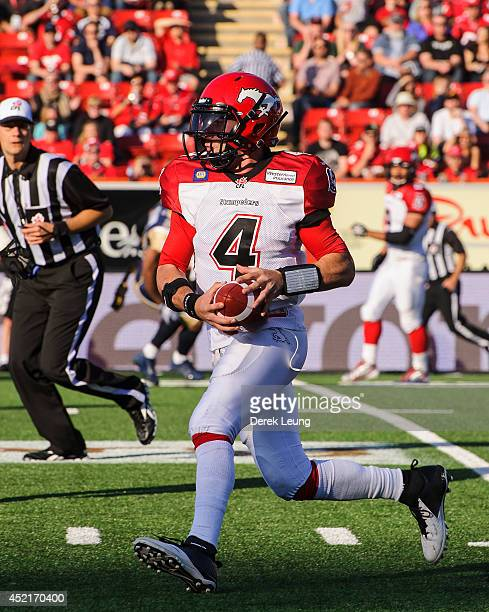 Drew Tate of the Calgary Stampeders in action against the Winnipeg Blue Bombers during a CFL game at McMahon Stadium on June 14 2014 in Calgary...