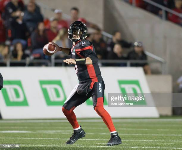 Drew Tate of the Ottawa Redblacks looks downfield for a receiver in Canadian Football League Action at TD Place Stadium in Ottawa Canada on Saturday...