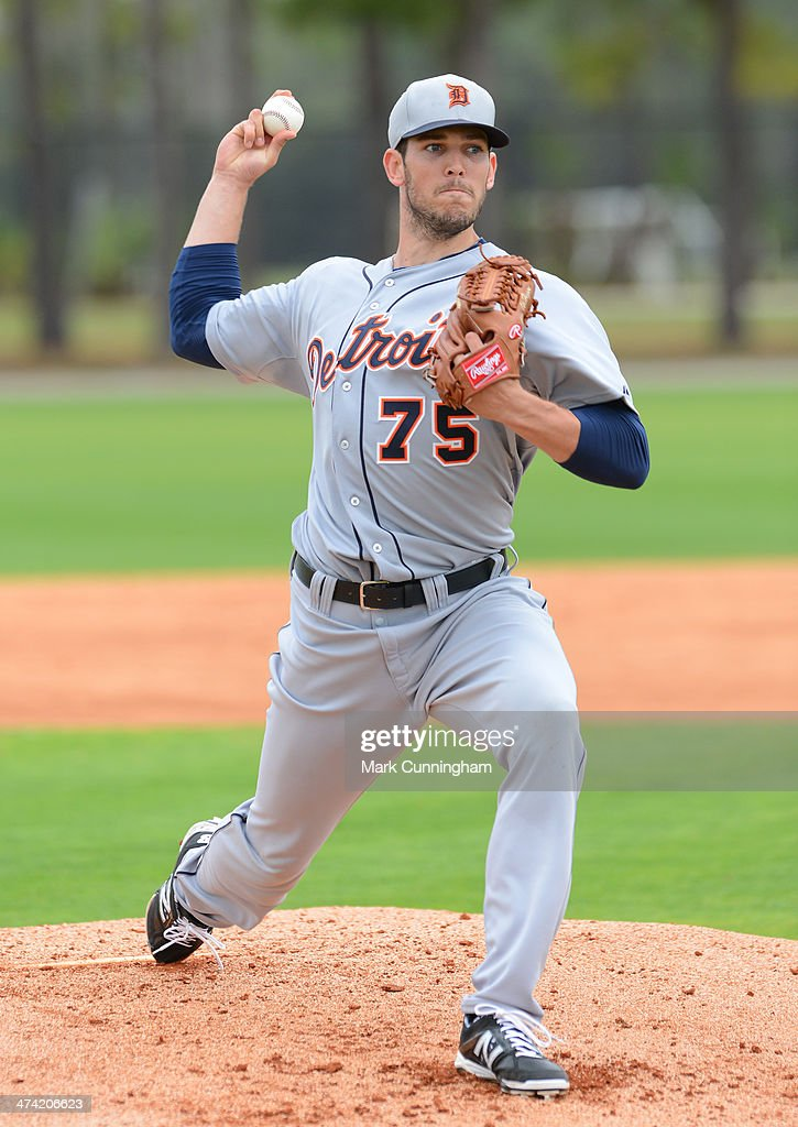 Drew VerHagen #75 of the Detroit Tigers pitches during the spring training workout day at the TigerTown complex on February 22, 2014 in Lakeland, Florida.