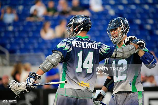 Drew Westervelt and Kevin Crowley of the Chesapeake Bayhawks celebrate a first half goal against the Charlotte Hounds at NavyMarine Corps Memorial...