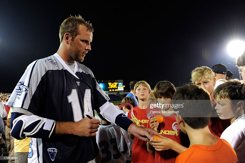 Drew Westervelt #14 of Chesapeake Bayhawks signs autographs for fans after the Bayhawks defeated the Boston Cannons during a game at Navy-Marine Corps Memorial Stadium on July 18, 2013 in Annapolis, Maryland.