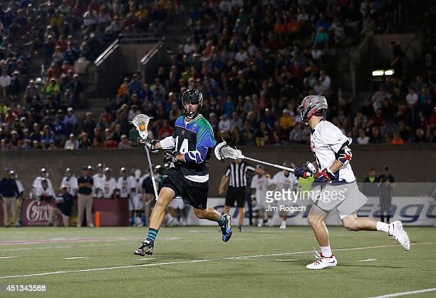 Drew Westervelt of Team MLL runs around a Team USA defender during the 2014 MLL All Star Game at Harvard Stadium on June 26 2014 in Boston...