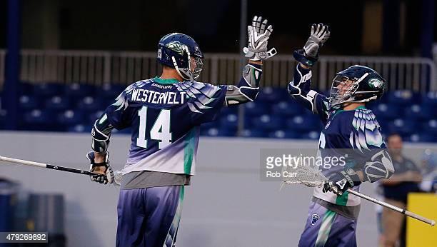 Drew Westervelt of the Chesapeake Bayhawks celebrates a first half goal with teammate Ben Rubeor against the New York Lizards at NavyMarine Corps...