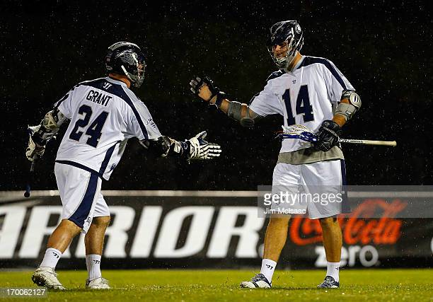 Drew Westervelt of the Chesapeake Bayhawks celebrates his seventh goal against the New York Lizards with teammate John Grant Jr #24 during their...
