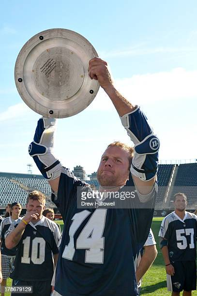 Drew Westervelt of the Chesapeake Bayhawks holds the championship trophy after beating the Charlotte Hounds 109 during the MLL Championship at PPL...