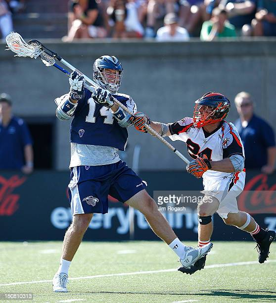 Drew Westervelt of the Chesapeake Bayhawks shoots on net by the defense of Chris O'Dougherty of the Denver Outlaws during the Major League Lacrosse...