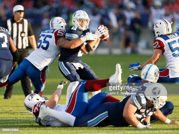 Drew Willy of the Toronto Argonauts gets sacked by Gabriel Knapton of the Montreal Alouettes during a CFL preseason game at BMO field on June 8 2017...