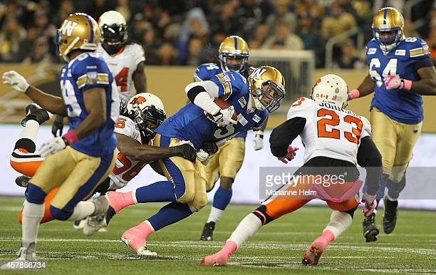Drew Willy of the Winnipeg Blue Bombers tries to gain yards in second half action in a CFL game against the BC Lions at Investors Group Field on...